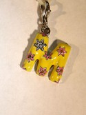 EL9204-Letter-M-Yellow-Floral-Charm-for-Bracelets-by-Ganz_105930A.jpg