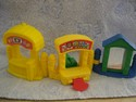 Fisher-Price-Little-People-Carnival---Ticket-Booth-Mirror-and-Milk-Bottle-Game_175946A.jpg