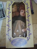 NIGC-New-In-Box-Genuine-Hand-Painted-Porcelain-Doll._145065A.jpg