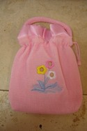 Pink-Hand-Bag-with-Flower-Design-and-Drawstring-Closure_182391A.jpg