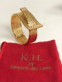 KJL-Hammered-Goldtone-Rhinestone-Hinged-Bangle-Buckle-Bracelet-wpouch_34538A.jpg