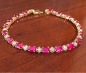 VINTAGE-10K-YELLOW-GOLD-SIMULATED-RUBIES-NATURAL-DIAMONDS-LADIES-TENNIS-BRACELET_34553B.jpg