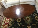 Riches Mahogany Oval  Coffee Table w/brass casters