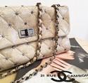 Chanel-Mademoiselle-Flap-Handbag_122835A.jpg