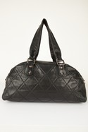 Chanel-Black-Quilted-Leather-Shoulder-Bag-with-Copper-Hardware_32495D.jpg